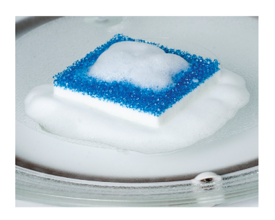 Glisten microwave cleaner scrubber foaming on glass turntable