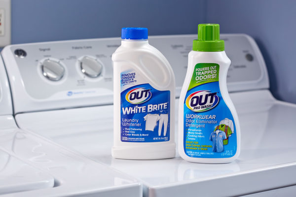 OUT Laundry product packages on dryer - ProWash Workwear Odor Eliminator and White Brite Laundry Whitener