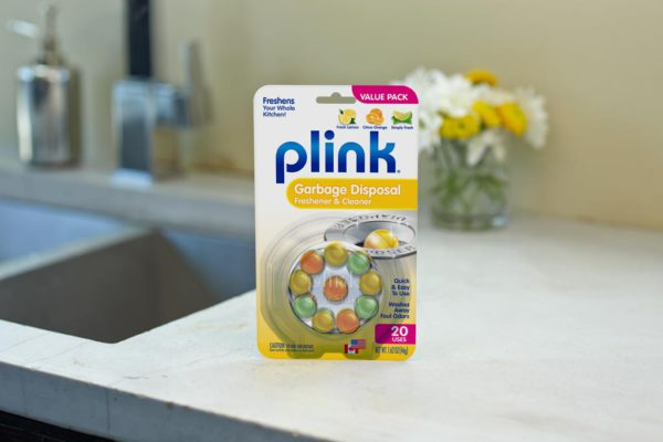 Plink® Garbage Disposal Freshener & Cleaner - Assorted Fragrances package beside kitchen sink