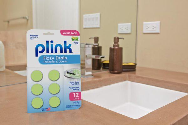 Plink® Fizzy Drain Freshener & Cleaner – Simply Fresh package beside bathroom sink