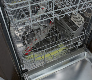 Dishwasher with Glisten detergent booster powder in bottom
