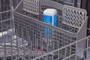 Glisten Dishwasher Cleaner in use in dishwasher silverware rack