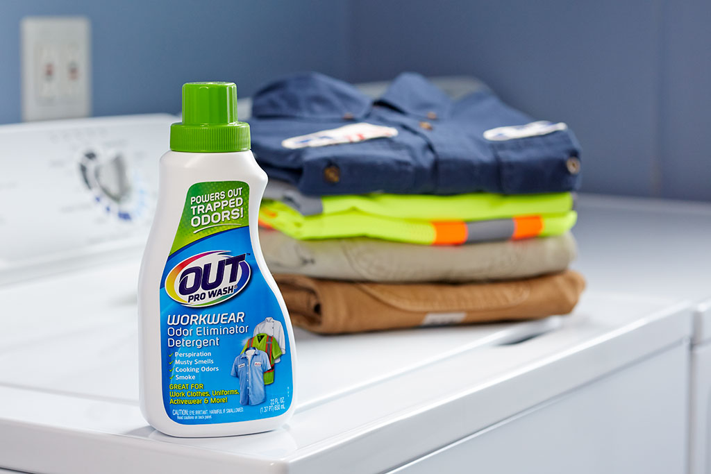 OUT ProWash clothes deodorizer detergent with work laundry on washer